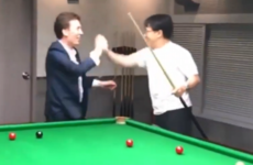 Hollywood actor Jackie Chan impresses Ken Doherty with trick shot