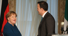 In a 'moving' meeting with North community members, Merkel compared border issue to Iron Curtain