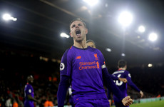 Salah and Henderson strike late to send Liverpool back top of the Premier League