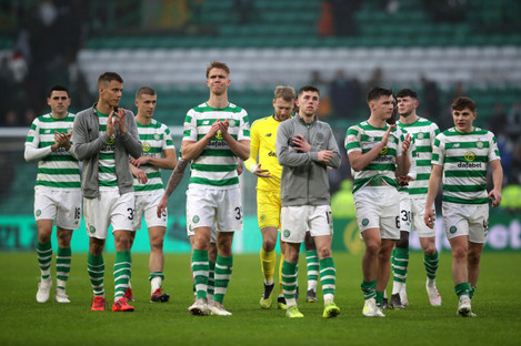 Celtic players pictured after the final whistle.