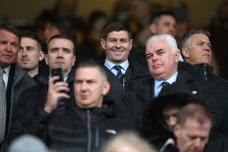 Steven Gerrard watches on from the stands as he serves a one-game touchline ban.