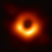 This is the first ever image of a black hole, located in a galaxy 53 million light years away