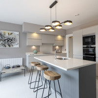 Coastal living with city convenience in these three-storey family homes