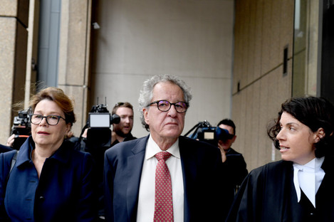 Actor Geoffrey Rush leaves court today