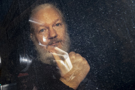 Julian Assange arrives at Westminster Magistrates' Court in London.