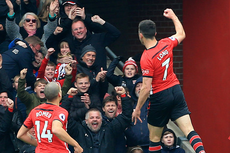 Shane Long celebrates after scoring Southampton's third goal against Wolves.