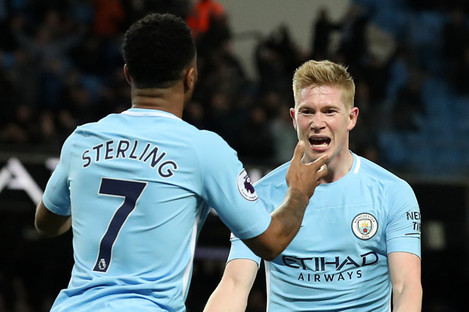Kevin De Bruyne celebrates with Raheem Sterling after scoring against West Brom in January 2018.