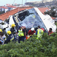 Death toll in Portuguese tourist bus crash rises to 29 after woman dies in hospital