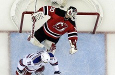 A New York Rangers player ignited a brawl by sucker-punching the Devils goalie