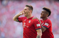 Bayern remain ahead of Dortmund after Süle strike edges champions past 10-man Bremen