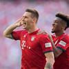 Bayern remain ahead of Dortmund after Süle strike edges champions past 10-man Bremen