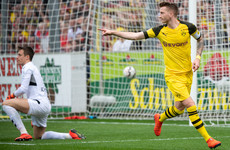 Reus fires Dortmund to victory to keep the heat on Bayern in Bundesliga title race