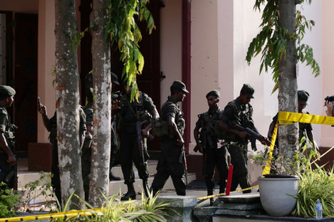 The St. Sebastian's Church where a blast took place is cordoned off in Negombo, north of Colombo yesterday