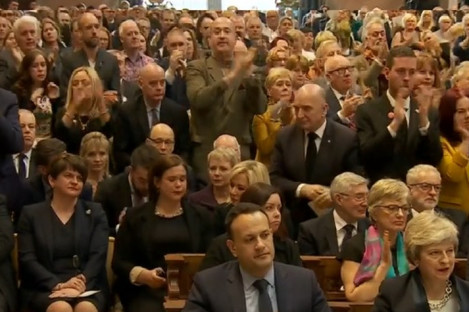 Standing ovation breaks out at Lyra McKee's funeral when priest challenges politicians about Northern Ireland stalemate.
