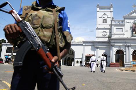 A guard near St Anthony's Shrine in Sri Lanka, where one of eight bombs exploded last Sunday.