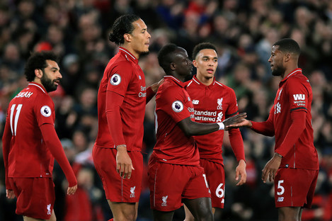 Liverpool's Sadio Mane (centre) celebrates scoring his side's second goal of the game.