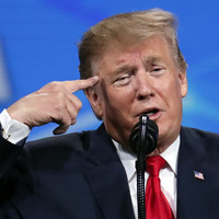 Man throws phone at Trump during gun rally