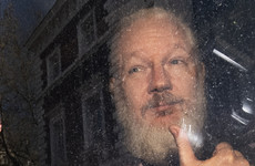 Julian Assange sentenced to 50 weeks in jail for breaching bail in UK