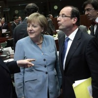 EU summit: Merkel rejects eurobonds as Britain rules out financial transaction tax