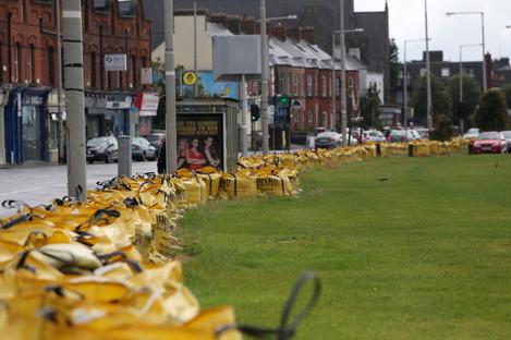 Sandbags placed along the coast road of the Clontarf Road in Dublin ahead of a Status Orange rain warning.