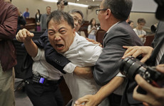 Photos: Anarchy in Hong Kong parliament as politicians scuffle over extradition row