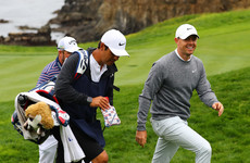 McIlroy five back as Woodland produces gritty display to retain US Open lead