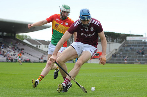 Galway's Conor Cooney in action against Paul Doyle.