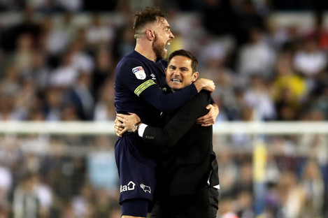Richard Keogh (left) celebrates Derby County's victory with manager Frank Lampard.