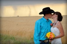 VIDEO: Couple tie the knot... as 250kph tornado drops behind them