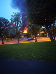 Police seeking two suspects as Derry church building destroyed in arson attack