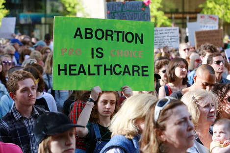 People participate in a protest against abortion ban.