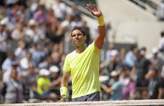 Defending champ Nadal opens record-extending Roland Garros bid positively as Wozniacki crashes out