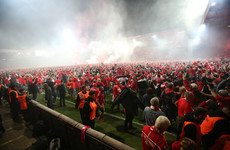 Brilliant scenes as fans invade pitch after Berlin club claim promotion to Bundesliga for the first time