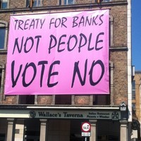Mick Wallace erects giant pink Vote No banner on Dublin restaurant