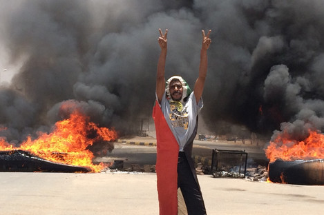 A protester pictured near the army headquarters in Khartoum yesterday.