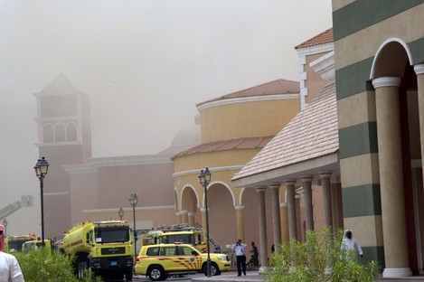 Emergency vehicles stand outside the Villaggio Mall