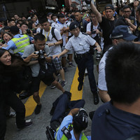 Demonstrators clash with police after more than a million people turn out for Hong Kong protests