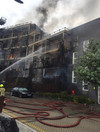 100 firefighters tackle massive blaze at block of flats in east London
