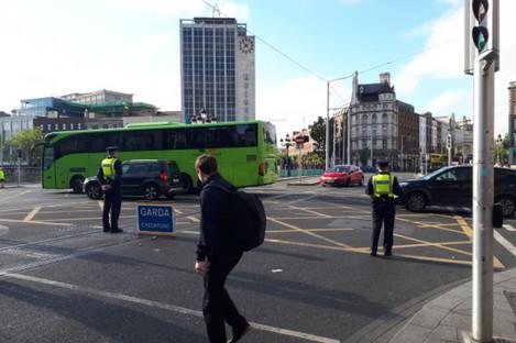 Gardaí block the entrance to the street at O'Connell Bridge.