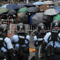 Police fire tear gas at Hong Kong protesters amid clashes over extradition plans