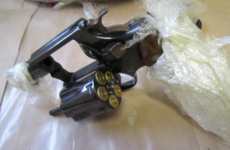 Two handguns wrapped in cling film found during gangland searches