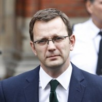 Former Cameron aide and NoTW editor held on suspicion of perjury
