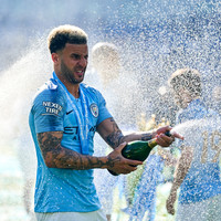 Walker pens two-year extension with treble champions City