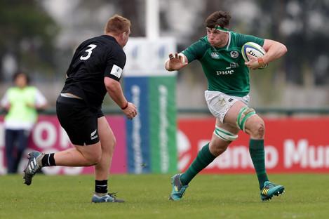 Ryan Baird makes a burst around Fletcher Newell.