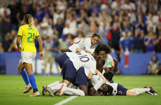 Captain Henry fires hosts France past Brazil into World Cup last eight