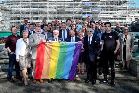 Ceann Comhairle Seán Ó Fearghaíl with the Pride flag that will fly over Leinster House on Saturday.