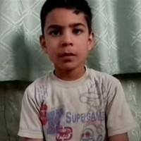 Syria: 11-year-old played dead to survive Houla massacre