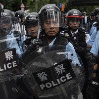 Hong Kong protest: Riot police fire tear gas on crowd hours after group breaches parliament