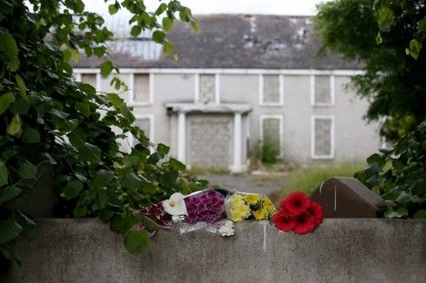 Fresh flowers at the scene outside a deserted building in Lucan where Ana Kriegel was murdered last year.