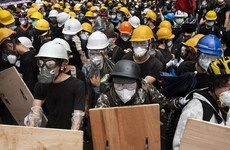 Hong Kong's leader condemns 'extreme use of violence' by masked protesters